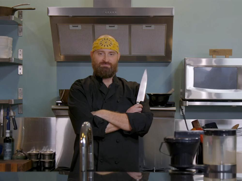 Chef with kitchen knife preparing meal