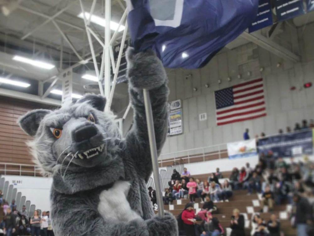 Michigan City High School wolf mascot at pep rally